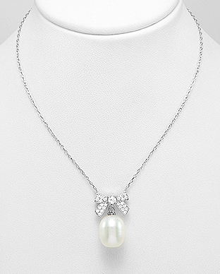 382-5280 - 925 Sterling Silver Necklace Featuring Bow Decorated With Fresh Water Pearl And CZ