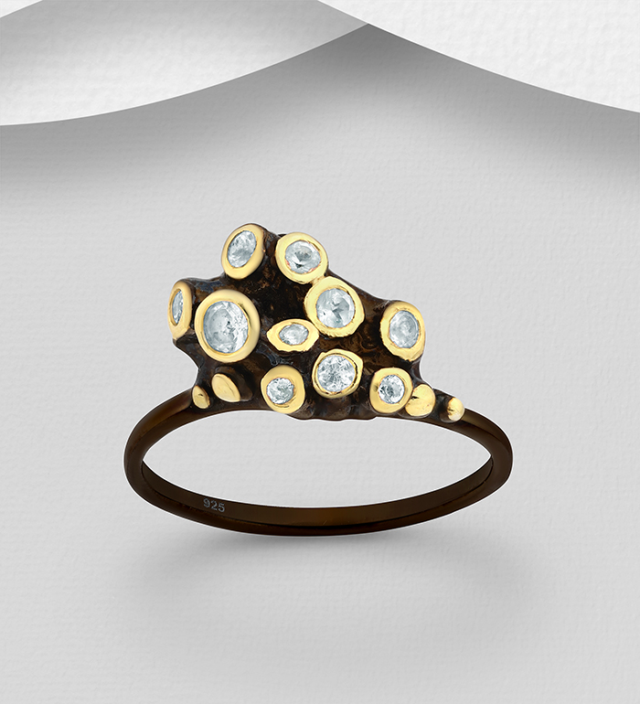 1916-23 - ADIORE JEWELS - 925 Sterling Silver Ring Decorated with Sky-Blue Topaz, Plated with 3 Micron 22K Yellow Gold and Black Rhodium