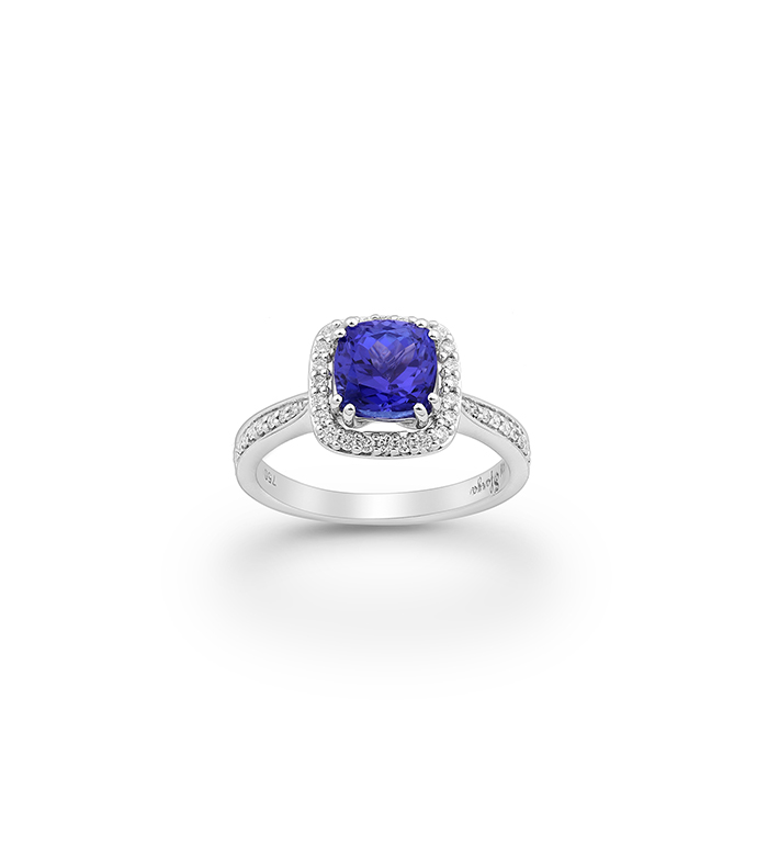 33-0066 - Halo Engagement Ring in 18K White Gold, Decorated with Tanzanite and Diamonds.