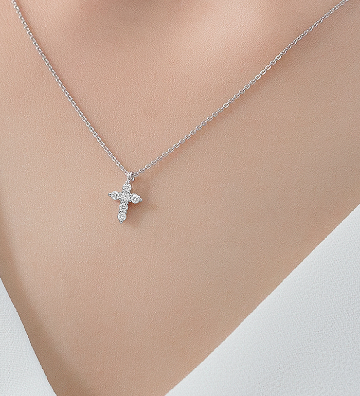 33-0088 - Cross Necklace in 18K White Gold, Decorated with Diamonds.